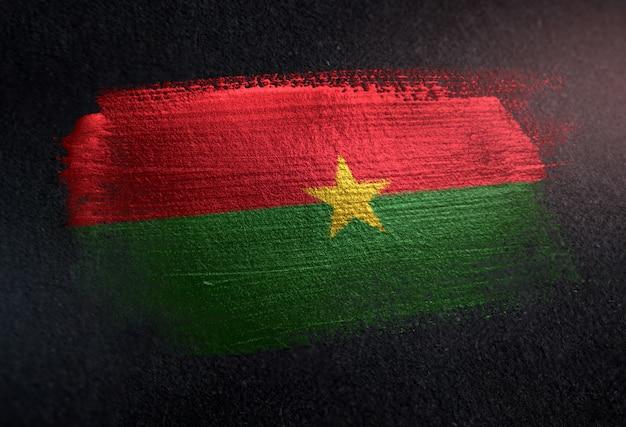 Burkina faso flag made of metallic brush paint on grunge dark wall