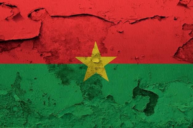 Burkina faso flag painted on grunge cracked wall