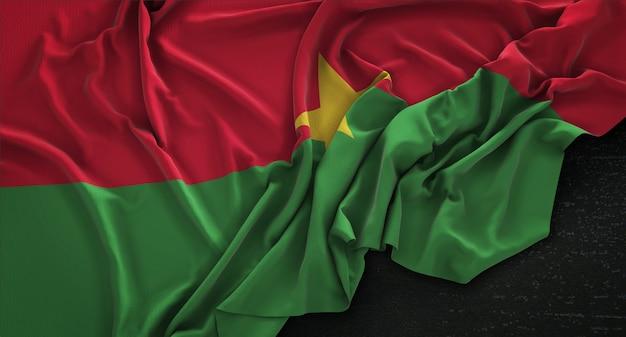 Burkina faso flag wrinkled on dark background 3d render