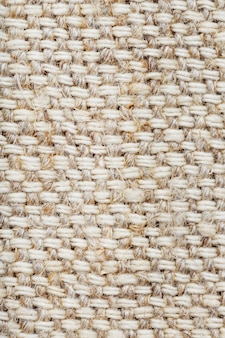 Burlap fabric with linen fibers as background. full screen macro
