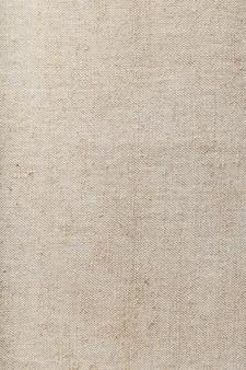 배경으로 린넨 섬유가 있는 삼베 직물. 전체 화면