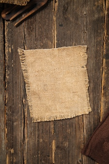 Burlap napkin on wood in country rustic style