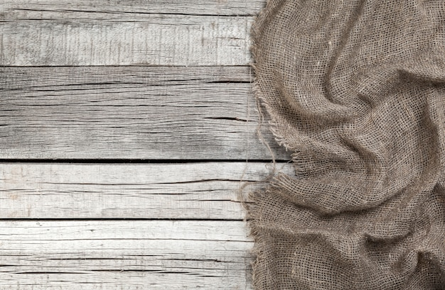 Burlap on old gray wooden background
