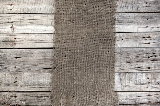 Burlap on old gray wooden,