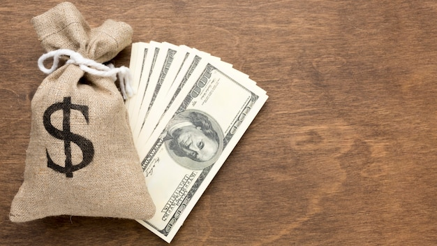 Burlap sack of money and bank-notes