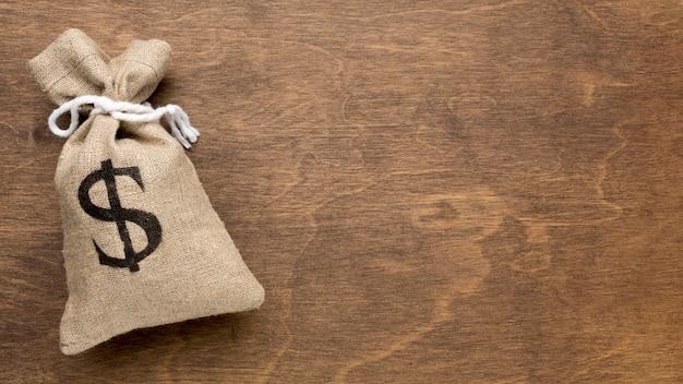 お金の黄麻布の袋コピースペース