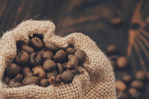 Burlap sack of roasted coffee beans.
