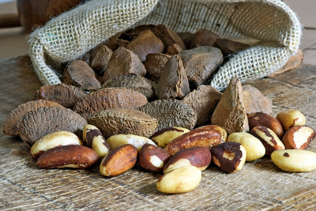 Burlap sack with spilled brazil nuts