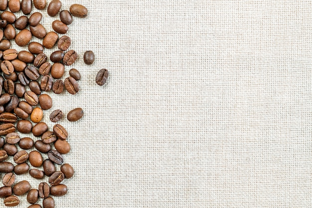 Burlap sackcloth canvas and coffee beans photo  copy space. coffee border