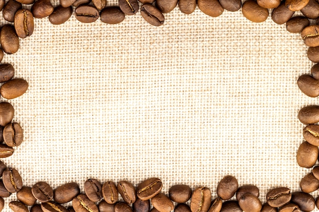 Burlap sackcloth canvas and coffee beans placed round in circle