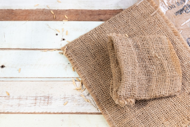 Burlap or sackcloth on wood table top view