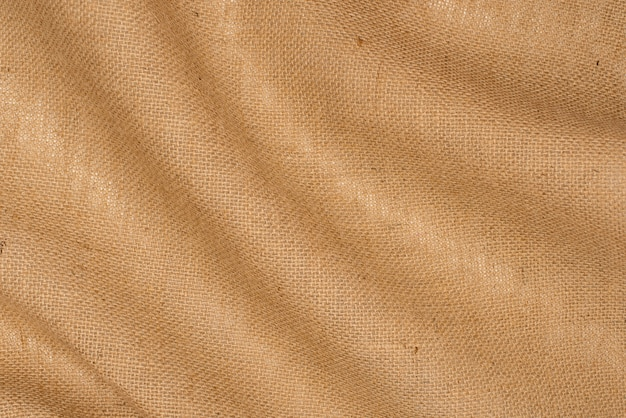 Burlap texture background. linen burlap drapery close up.