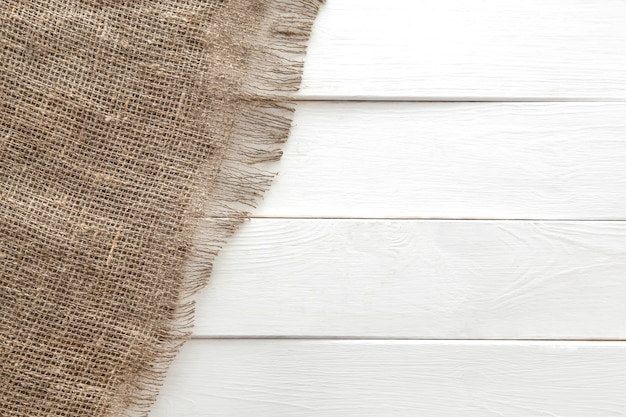 Burlap texture on white wooden background