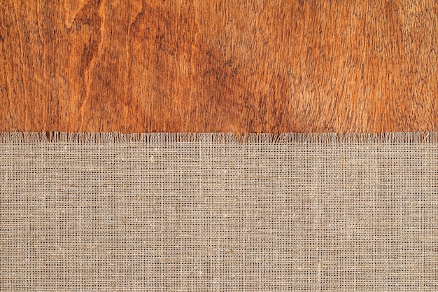 Burlap texture on wooden table surface