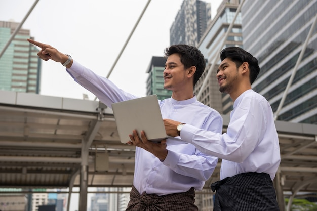 Burmese or myanmar businessmen in city