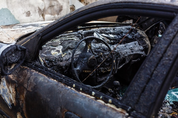 Burned car in the street