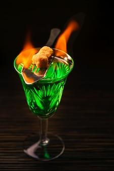 Burning absinthe in glass