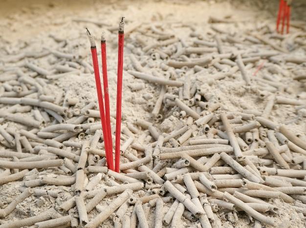 Burning aromatic incense sticks and ashes for praying buddha or hindu gods.