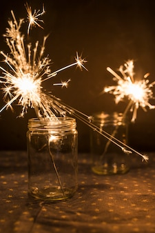 Burning bengal lights in jars