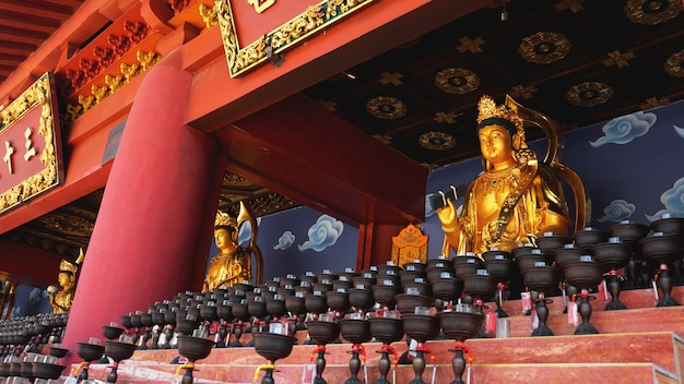 Burning big red candles in buddhist temple in china
