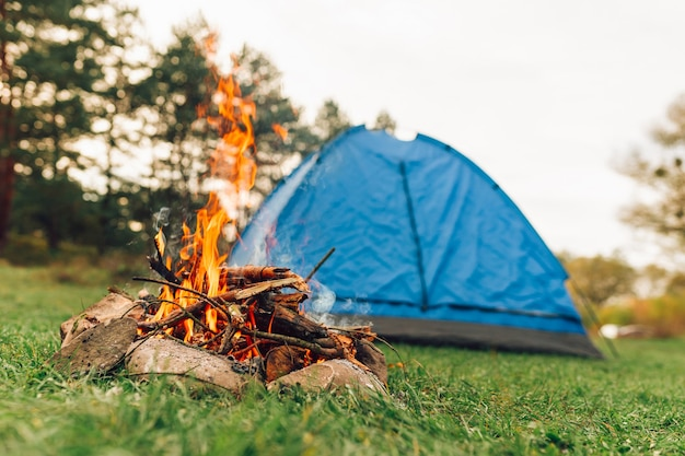 Burning campfire and tent