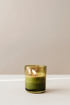 Burning candle in a glass mockup