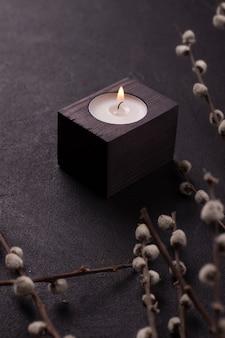 Burning candleon a black background.