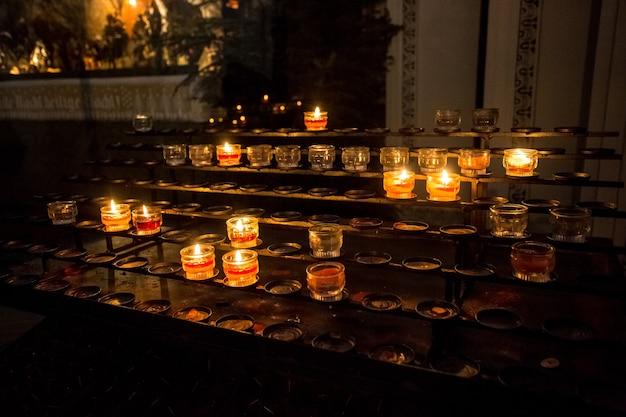 Burning candles on altar at church