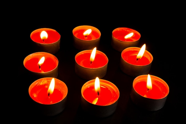 Burning candles on black background