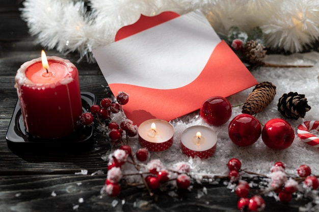 Burning candles and christmas decoration on wooden table