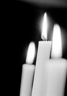 Burning candles, close-up (b&w)