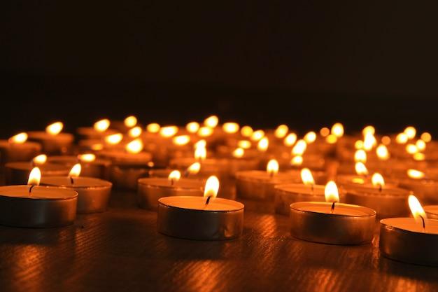 Burning candles on dark