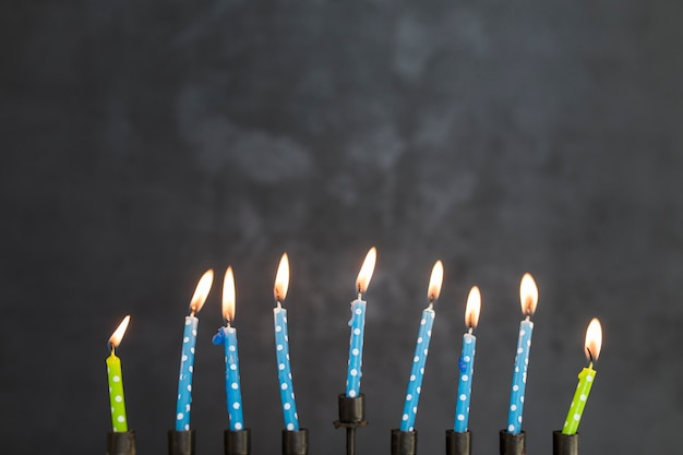 Burning candles of menorah