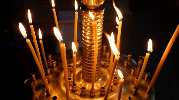 Burning candles in the orthodox church. christian faith