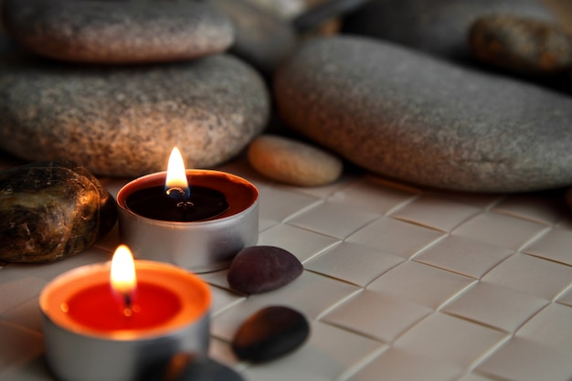 Burning candles. stone therapy. spa treatments.