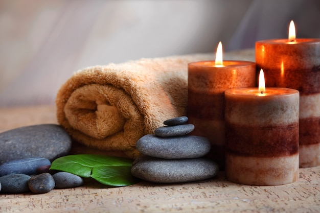 Burning candles and a towel. stone therapy. spa treatments.
