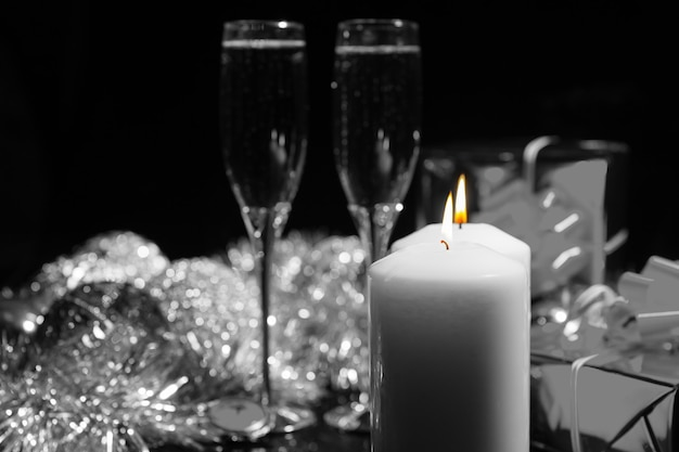 Burning candles with champagne and decorations