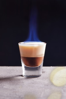 Burning chocolate vanilla cocktail in a glass
