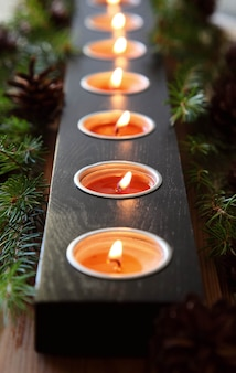Burning christmas candles. decorative ornaments.