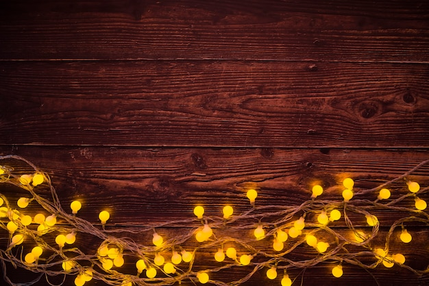 Burning garland on brown table