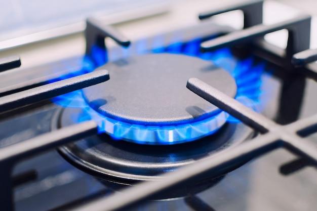 Burning gas burner on the stove.