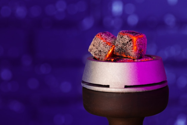 Burning hookah coals in hookah bowl