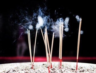 Burning incense stick with smoke
