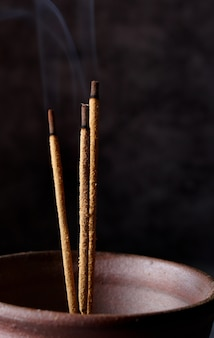 Burning incense sticks with smoke, copy space