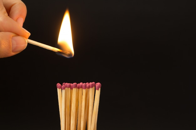 Burning match on a black background. the concept of fire. copy space.