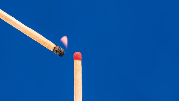 Burning match or matchstick set fire to another one
