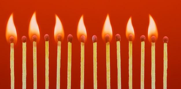 Burning matchsticks setting fire to its neighbors
