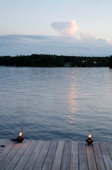 Burning oil lamps on a pier, lake of the woods, ontario, canada