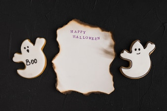 Burning paper between ghost gingerbread