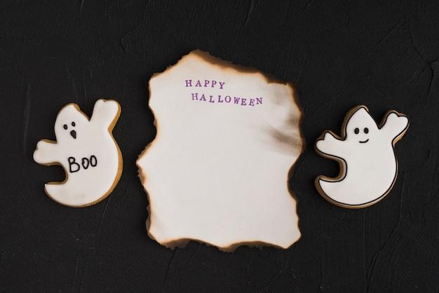 Burning paper between ghost gingerbread
